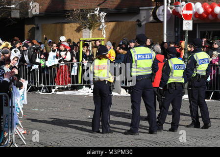 Police officers stand on the track of the Rosenmontag (Shrove Monday) carnival procession in Duesseldorf, Germany, - Stock Photo