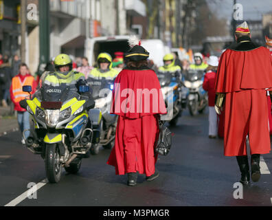 Police officers on motorbikes accompany the Rosenmontag (Shrove Monday) carnival procession in Duesseldorf, Germany, - Stock Photo
