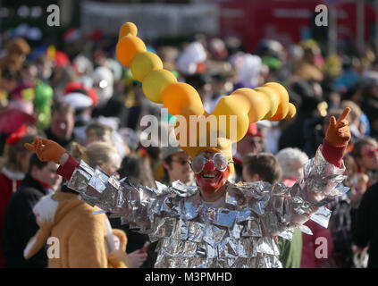 A carnival goer in costume takes part in the Rosenmontag (Shrove Monday) carnival procession in Duesseldorf, Germany, - Stock Photo