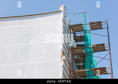 thermal exterior insulation of building. plastering and painting works during exterior wall renovations. - Stock Photo