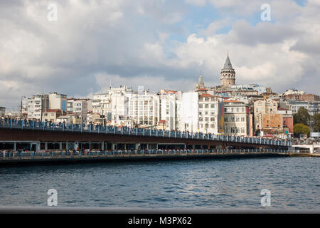 View of the Galata Bridge with fishermen and tourists. Istanbul, Turkey - Stock Photo