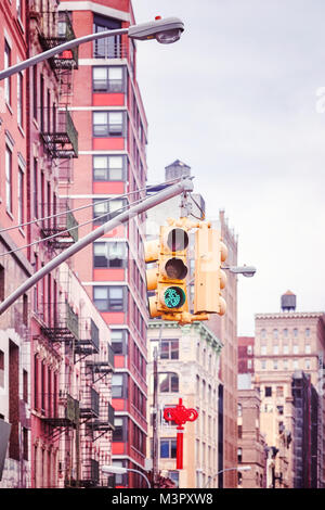New York City traffic lights with buildings on background , color toned picture, USA. - Stock Photo