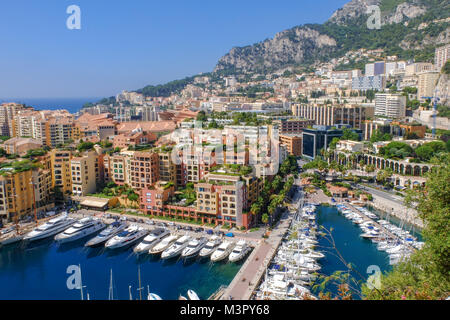 Fontvieille harbour view, town of Montecarlo, Monaco, luxury yachts in the bay - Stock Photo