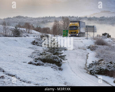 Articulated lorry travelling on the A82 in winter. As seen from the Commando Memorial near Spean Bridge, Scotland, - Stock Photo