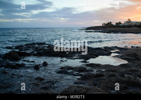 Costa Teguise, sunset view from the beach to the sea, Lanzarote - Stock Photo