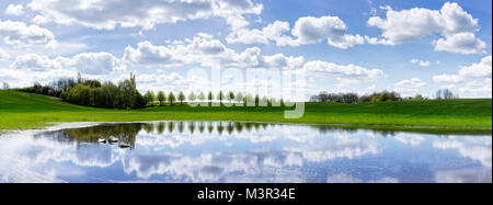 Panoramic view of a flooded field in northern Germany, Beautiful reflections on a bright spring day - Stock Photo