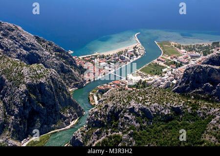 Aerial view - Omis city in Croatia. between Adriatic sea, mountain Omiska Dinara and river Cetina - Stock Photo