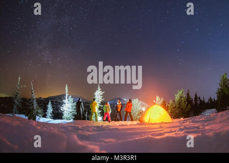 Travel night camping winter concept with friends and tent - Stock Photo