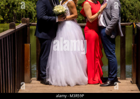 wedding couple , groomsman and bridesmaid (soft focus). - Stock Photo