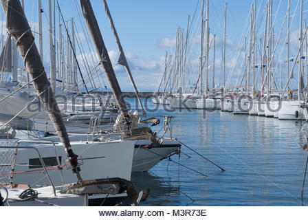 Sailboats in Alimos Marina on a partially cloudy day - Stock Photo
