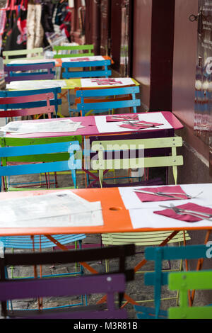 Paris - Very colorful Parisian outdoor cafe in Montmartre - Stock Photo
