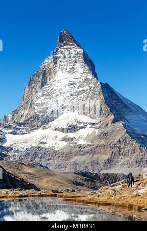 Matterhorn mountain view from Riffelsee lake, locate between Gornergrat train station, on high mountain in Zermatt, - Stock Photo