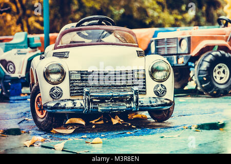 toy car, old and no one needed in an abandoned city - Stock Photo