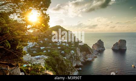 Panoramic view on Faraglioni rocks from Capri island, Italy - Stock Photo