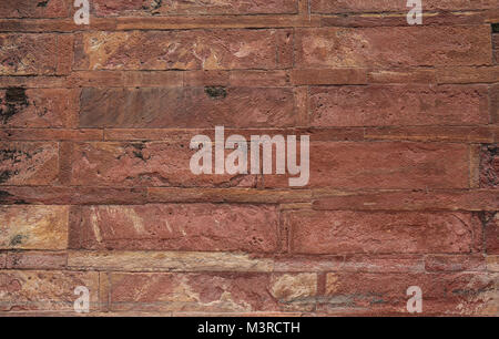 Sandstone wall of ancient fort in Agra, India. - Stock Photo