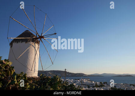 One of the iconic windmills overlooking the town of Mykonos (Chora), Cyclades Islands, Aegean Sea, Greece. - Stock Photo