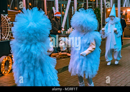 People in fluffy blue costumes in street - Stock Photo