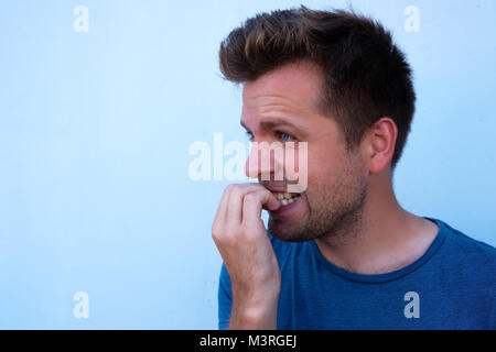 Caucasian mature man gnawing nails. Bad habit when you fell nervous and worry a lot. - Stock Photo