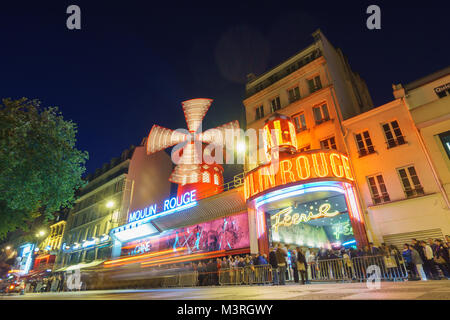 PARIS - MAY 15: The Moulin Rouge blurred motion by night, on May 15, 2015 in Paris, France. Moulin Rouge is a famous - Stock Photo