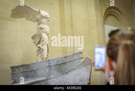 PARIS - MAY 16: Unidentified tourist taking photos to Venus de Milo at the Louvre Museum on May 16 2015 Paris, France. - Stock Photo