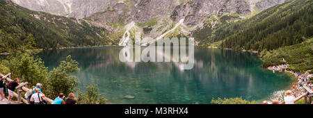 Polish Tatry Tatra,  crystal clear water lake pond in the mountain valley on sunny autumn day. Water reflections, - Stock Photo