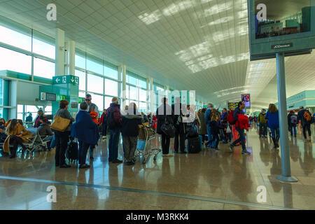 Barcelona El Prat airport with people queueing - Stock Photo