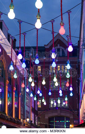 Art installation Oversized Light Bulbs above Ganton Street, Soho, City of Westminster, London, England, United Kingdom - Stock Photo
