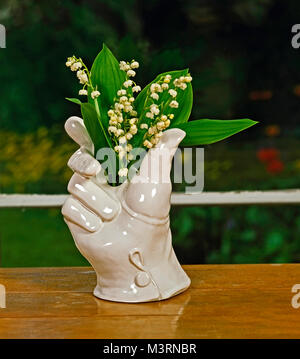 Lily-of-the-valley in a white hand vase - Stock Photo
