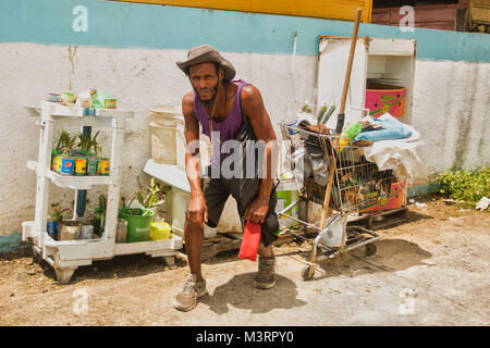 local character and goods beside Ocho Rios bus station, Jamaica, West Indies, Caribbean - Stock Photo