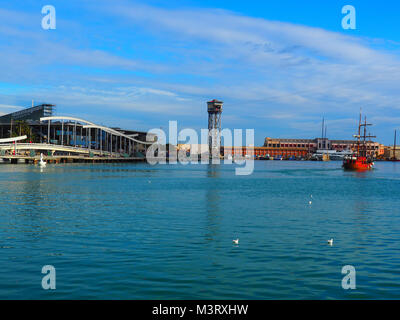 Port Vell in Barcelona, Spain. It is the old harbor of Barcelona with an area of sports boats, dock and a shopping - Stock Photo