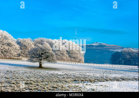 Winter scene as snow and frost cover the Lancashire landscape near Horwich Bolton with a backdrop of the famous - Stock Photo