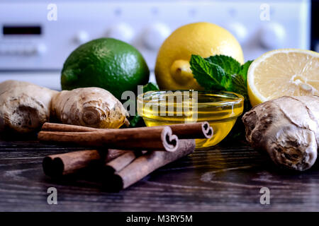 Drink from the lemon on the table. Lemon and ginger drink. The w - Stock Photo