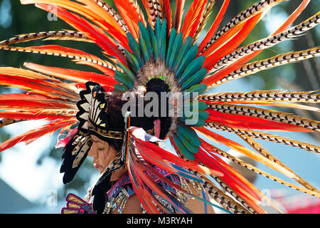 An Aztec heritage dancer wears traditional regalia for a performance during the annual Latino Heritage Festival - Stock Photo