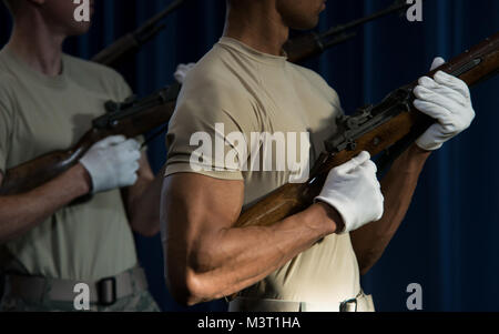 Staff Sgt. Damon Stewart charges an M1 Garand rifle during a practice three-round volley at Joint Base Anacostia - Stock Photo