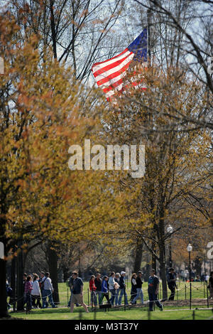 Visitors and tourist flock to the National Mall to visit the Vietnam Memorials to include The Vietnam Veterans Memorial - Stock Photo