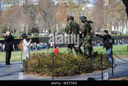 Visitors and tourist flock to the National Mall to visit the Three Servicemen (Sometimes called The Three Soldiers) - Stock Photo