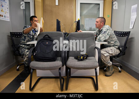 Bulgarian air force Sgt. Hristo Gyrov works hand in hand with Tech. Sgt. Brian Robisky planning the day's workload - Stock Photo