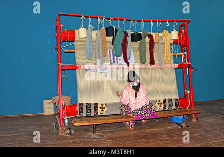 ANTALYA, TURKEY - MAY 02, 2012: Local woman weaves a carpet by hand in Antalya, Turkey - Stock Photo