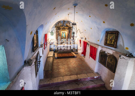 Interior of Church of Our Lady of Remedy on the slope of Saint John mountain above Old Town of Kotor town in Bay - Stock Photo