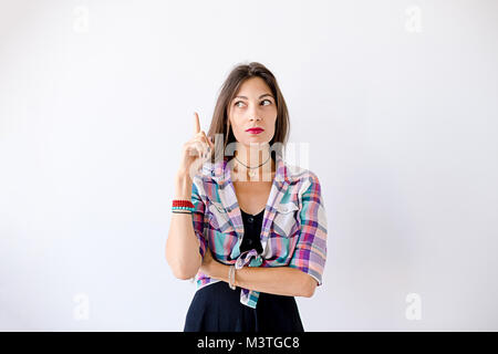 Aha. Eureka. Close Up portrait headshot young lady girl woman showing index finger pointing up remembered something - Stock Photo