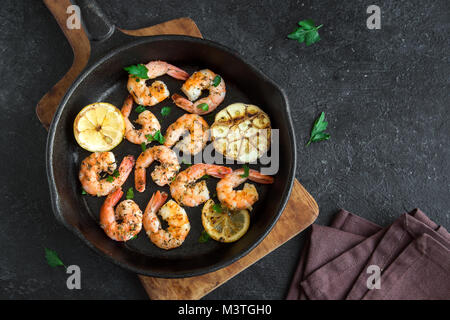 Roasted shrimps with lemon, garlic and herbs. Seafood, shelfish. Shrimps Prawns grilled with spices, garlic and - Stock Photo