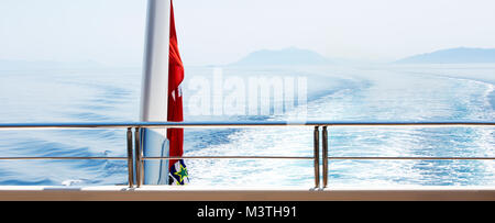 A view from the back of a super yacht cruising the mediterranean. - Stock Photo