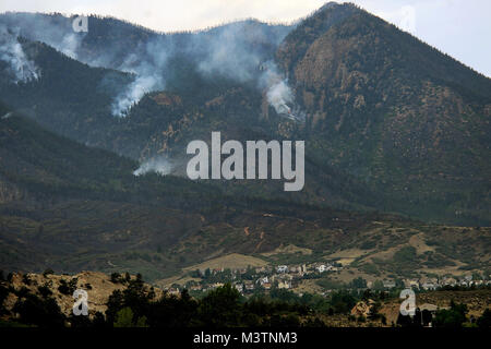 Sporadic fires burn in the Colorado Springs area during the Waldo Canyon fire. Nearby residents were evacuated as - Stock Photo