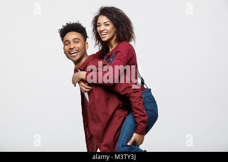 Close-up young african american couple enjoy riding back. - Stock Photo