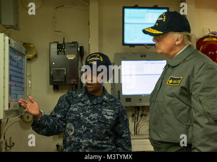 170302-N-ZE240-0224 NEWPORT NEWS, Va. (March 2, 2017) President Donald J. Trump tours Pre-Commissioning Unit Gerald R. Ford (CVN 78).  Trump visited March 2 to meet with Sailors and shipbuilders of the Navy's first-in-class aircraft carrier during an all-hands call inside the ship's hangar bay. (U.S. Navy photo by Mass Communication Specialist 3rd Class Cathrine Mae O. Campbell/Released) 170302-N-ZE240-0224 by Photograph Curator