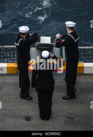 PACIFIC OCEAN (Mar. 15, 2017) Sailors assigned to the aircraft carrier USS Nimitz (CVN 68) render honors while committing - Stock Photo
