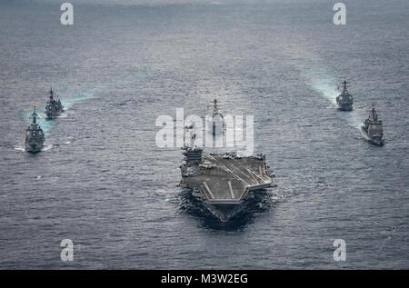 170428-N-GD109-017  PHILIPPINE SEA (April 28, 2017) The Nimitz-class aircraft carrier USS Carl Vinson (CVN 70) leads - Stock Photo