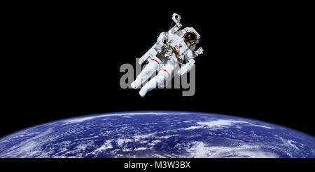 Astronaut in outer space over the planet earth. Elements of this image furnished by NASA
