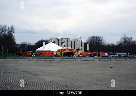 Stuttgart, Germany - February 03, 2018: The striped circus tent of the circus Palazzo on with an entrance gate and - Stock Photo