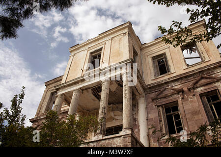 View of old, historical, ruined house in Cunda (Alibey) Island. Image reflects of Aegean / Greek architectural style. - Stock Photo